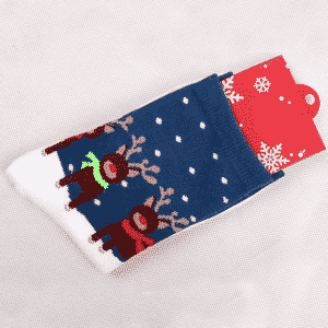 A pair of white socks with reindeer in the snow image